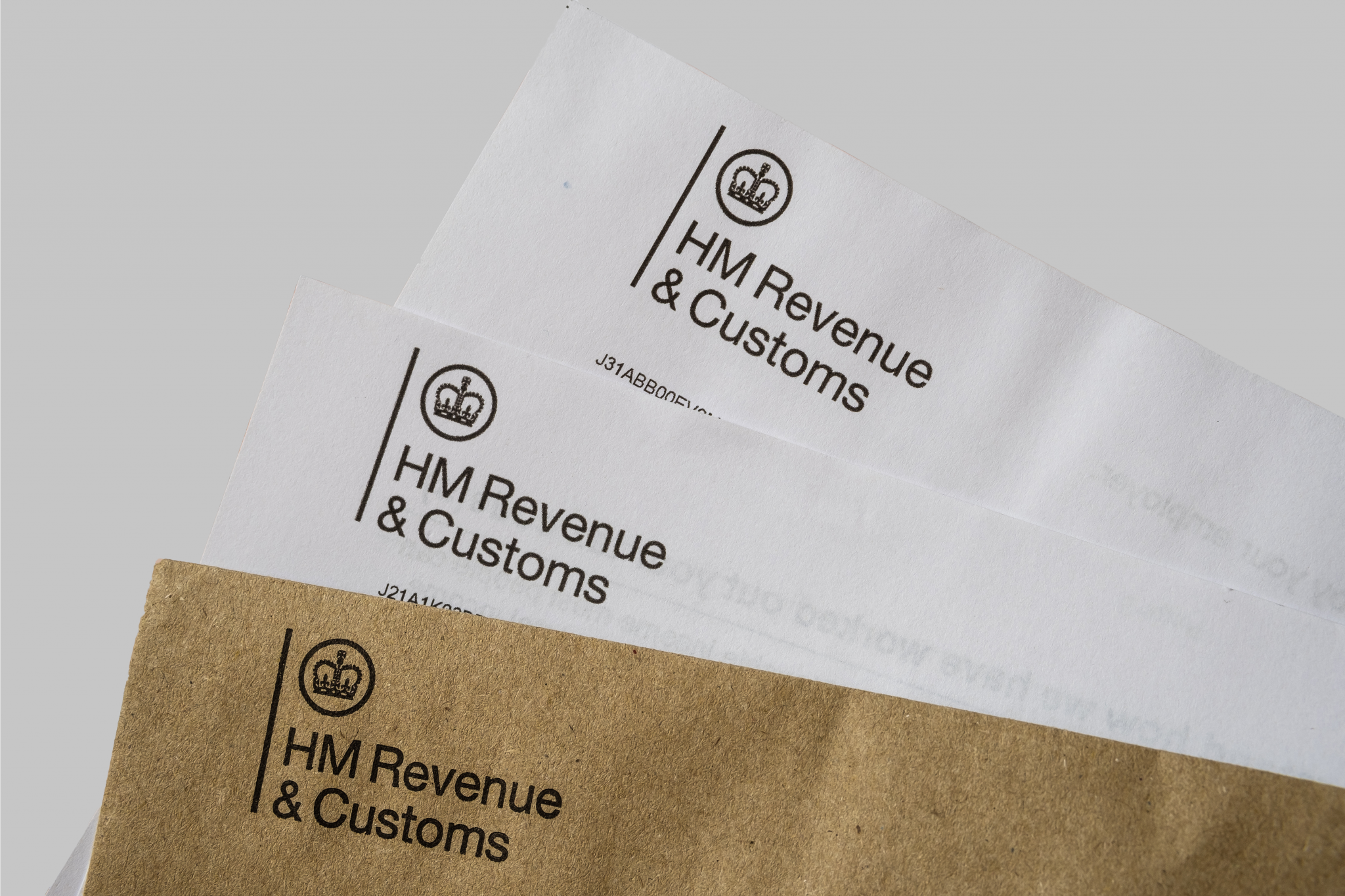 Stack of HMRC letters and envelope